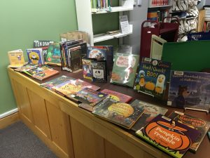 [Halloween picture books displayed on the Youth Services Desk.]